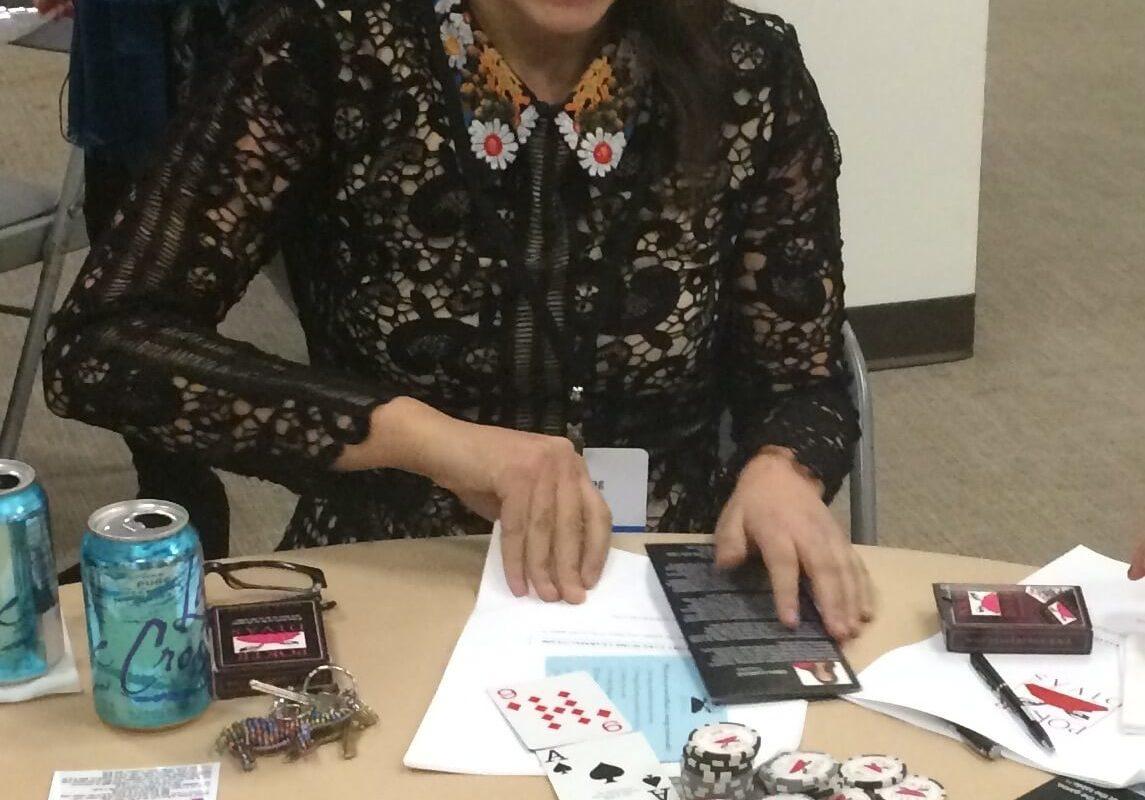 Poker Divas - A women is smiling
