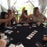 Poker Divas - two women high five