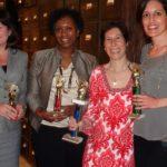 Poker Divas - Women posing with prizes