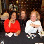 Poker Divas - Three women smiling