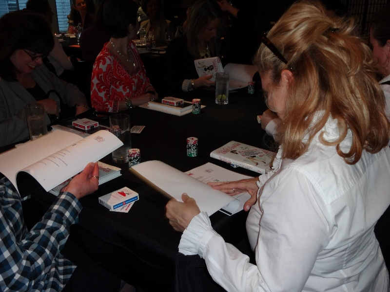 Poker Divas - Women reading instruction